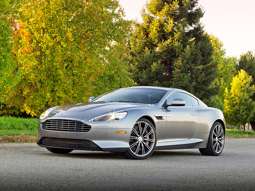 AUT 06 RK0154 01 © Kimball Stock 2012 Aston Martin Virage Silver 3/4 Front View On Pavement By Autumn Trees