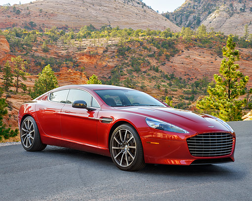 AUT 06 RK0185 01 © Kimball Stock 2015 Aston Martin Rapide S 4-Door Sports Car Red 3/4 Front View In Desert