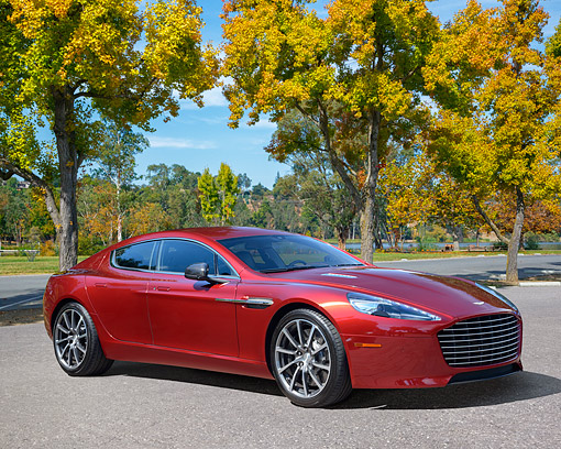 AUT 06 RK0188 01 © Kimball Stock 2015 Aston Martin Rapide S Red 3/4 Front View By Trees