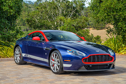 AUT 06 RK0190 01 © Kimball Stock 2015 Aston Martin Vantage GT Blue 3/4 Front View By Trees