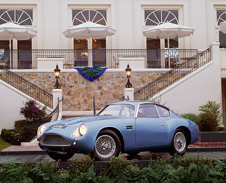 AUT 06 RK0002 01 © Kimball Stock 1962 Aston Martin Zagato DB4 GT Blue 3/4 Front View In Front Of Lodge