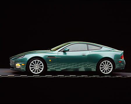 AUT 06 RK0018 01 © Kimball Stock 2002 Aston Martin Vanquish Green Profile View Studio Checkered Floor
