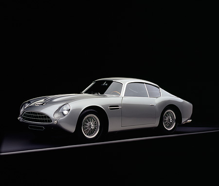 AUT 06 RK0024 07 © Kimball Stock 1962 Aston Martin DB4 GT Zagato Silver 3/4 Side View On Gray Line Studio
