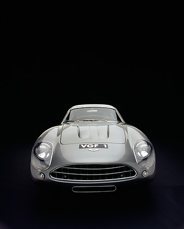 AUT 06 RK0025 06 © Kimball Stock 1962 Aston Martin DB4 GT Zagato Silver Wide Angle Head On Shot Studio