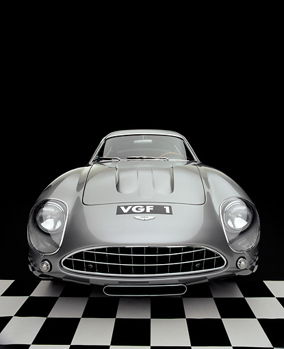 AUT 06 RK0026 08 © Kimball Stock 1962 Aston Martin DB4 GT Zagato Silver Wide Angle Head On Shot On Checkered Floor Studio