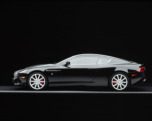 AUT 06 RK0067 06 © Kimball Stock 2005 Aston Martin DB9 Coupe Black Profile On Gray Line Studio