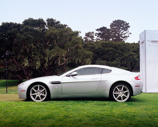 AUT 06 RK0083 01 © Kimball Stock 2006 Aston Martin DB7 Vantage Silver Profile Shot On Grass
