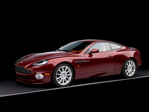 AUT 06 RK0087 01 © Kimball Stock 2006 Aston Martin V12 Vanquish S Merlot Red 3/4 Side View Studio