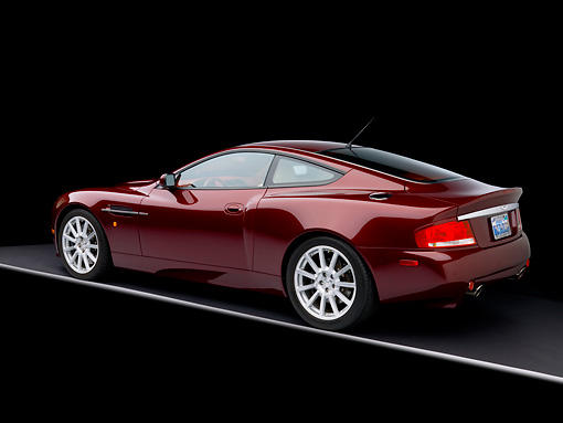 AUT 06 RK0089 01 © Kimball Stock 2006 Aston Martin V12 Vanquish S Merlot Red 3/4 Rear View Studio
