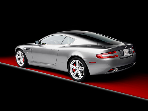 AUT 06 RK0120 01 © Kimball Stock 2009 Aston Martin DB9 Silver 3/4 Rear View Studio