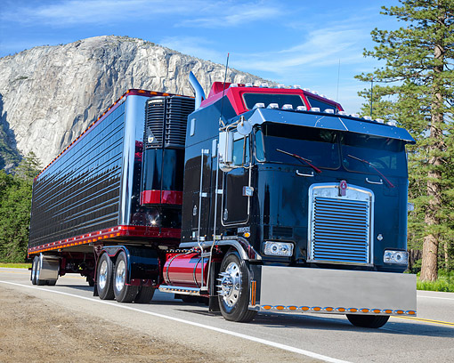 AUT 07 BK0022 01 © Kimball Stock 2003 Kenworth K100 Black And Red 3/4 Front View By Mountains