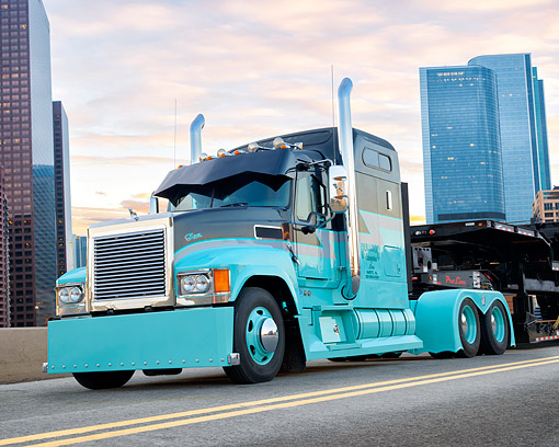 AUT 07 BK0031 01 © Kimball Stock 2010 Mack CHU613 Gray And Turquoise 3/4 Front View By City
