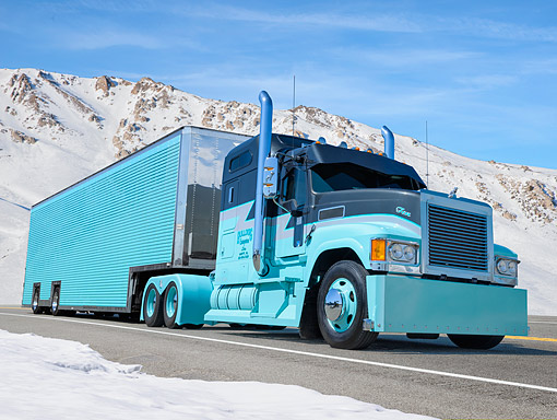 AUT 07 BK0032 01 © Kimball Stock 2010 Mack CHU613 Gray And Turquoise 3/4 Front View By Snowy Mountains