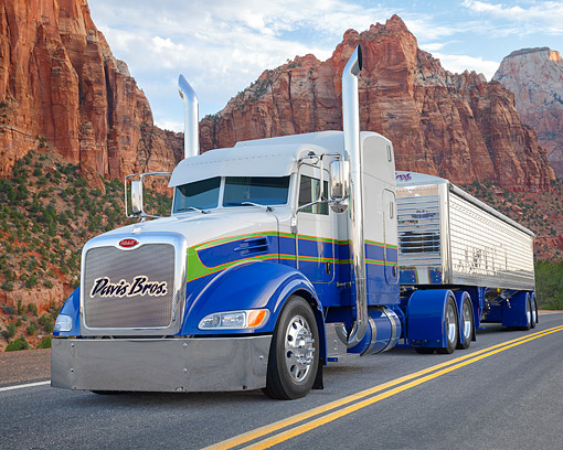 AUT 07 BK0035 01 © Kimball Stock 2015 Peterbilt 386 Blue And White 3/4 Front View In Desert