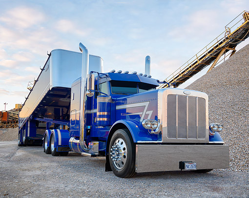 AUT 07 BK0037 01 © Kimball Stock 2015 Peterbilt 389 Blue 3/4 Front View In Construction Site