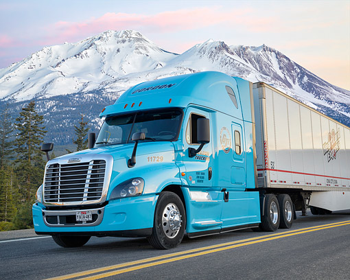 AUT 07 BK0043 01 © Kimball Stock 2016 Freightliner Cascadia Blue 3/4 Front View By Snowy Mountains