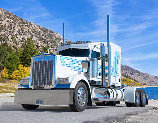 AUT 07 BK0044 01 © Kimball Stock 2016 Kenworth W900L White And Blue 3/4 Front View By Mountain Lake