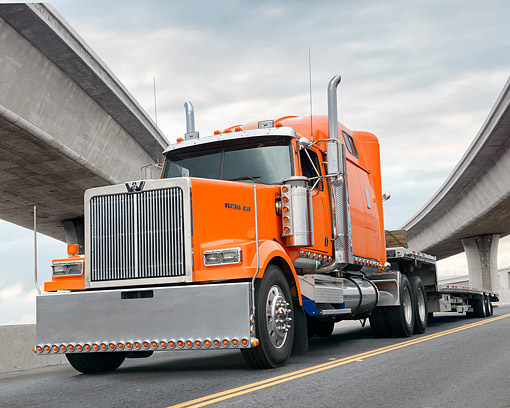 AUT 07 BK0055 01 © Kimball Stock 2016 Western Star 4900 Orange 3/4 Front View By Freeway Overpasses