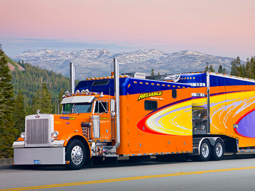 AUT 07 RK0052 01 © Kimball Stock 1985 Peterbilt 359 Orange And Blue 3/4 Side View On Road In Mountains