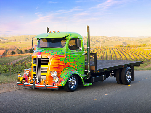 AUT 07 RK0066 01 © Kimball Stock 1938 GMC COE Flatbed Truck Green With Flames 3/4 Front View On Road By Vineyard