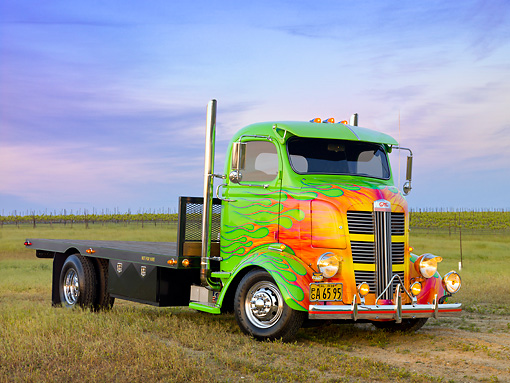 AUT 07 RK0070 01 © Kimball Stock 1938 GMC COE Flatbed Truck Green With Flames 3/4 Front View On Grass By Vineyard