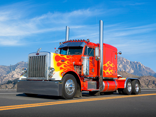 AUT 07 RK0161 01 © Kimball Stock 1981 Peterbilt 359 Red With Yellow Flames 3/4 Front View On Road By Mountains