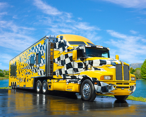 AUT 07 RK0171 01 © Kimball Stock 1996 Kenworth T-600 Yellow And Checkered 3/4 Front View On Wet Pavement By Water