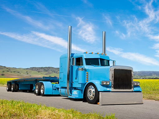AUT 07 RK0217 01 © Kimball Stock 2004 Peterbilt 379 Baby Blue 3/4 Front View On Pavement By Meadow