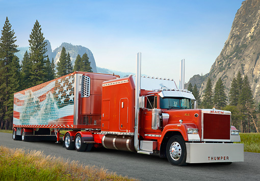 AUT 07 RK0239 01 © Kimball Stock 1991 Mack Superliner Burnt Orange 3/4 Front View On Road In Mountains