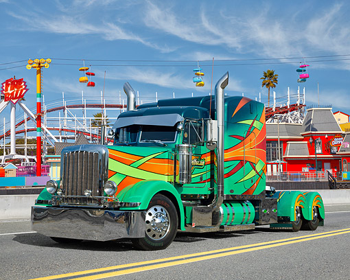 AUT 07 RK0316 01 © Kimball Stock 2000 Peterbilt 379 Multicolored 3/4 Front View On Road By Roller Coaster