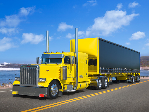 AUT 07 RK0338 01 © Kimball Stock 2003 Peterbilt 379 Yellow 3/4 Front View On Road By Beach