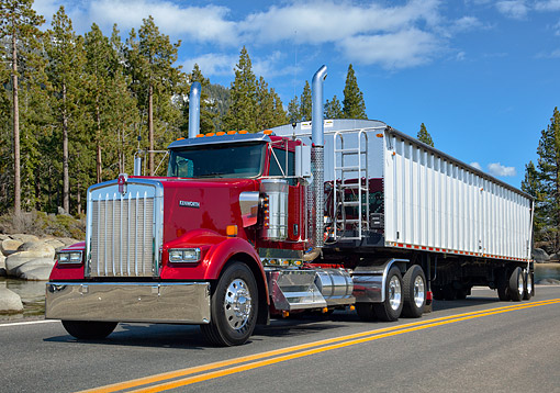 AUT 07 RK0346 01 © Kimball Stock 2011 Kenworth W900L Burgundy 3/4 Front View On Road By Lake And Trees