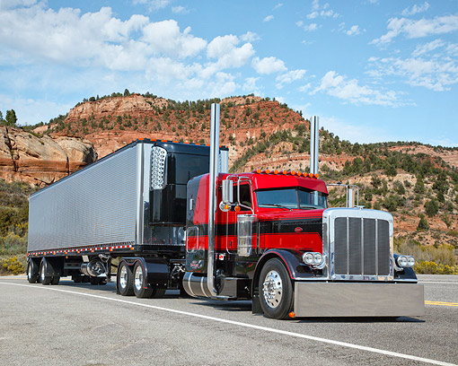 AUT 07 RK0376 01 © Kimball Stock 2011 Peterbilt 389 Red With Black Stripe 3/4 Front View On Road In Desert