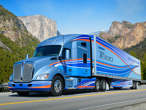 AUT 07 RK0390 01 © Kimball Stock 2013 Kenworth T680 Blue 3/4 Front View On Road In Mountains