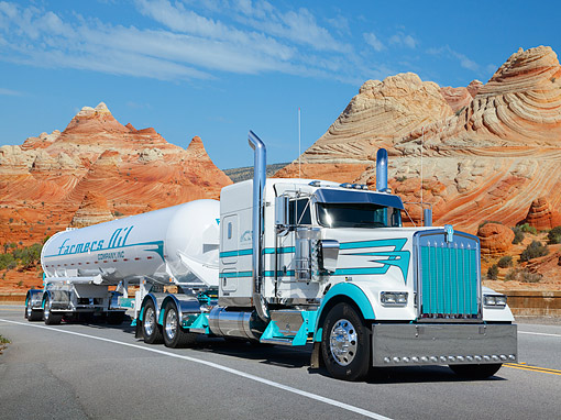 AUT 07 RK0391 01 © Kimball Stock 2013 Kenworth W9L White And Teal 3/4 Front View On Road By Red Rock