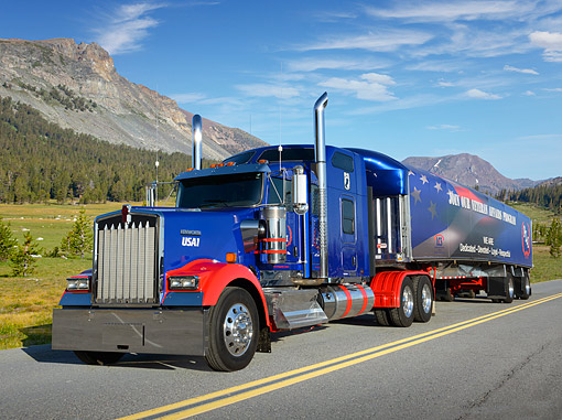 AUT 07 RK0392 01 © Kimball Stock 2013 Kenworth W900 Blue And Red 3/4 Front View On Road By Mountains