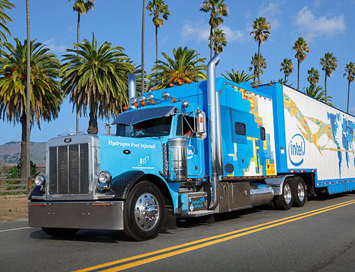 AUT 07 RK0394 01 © Kimball Stock 2000 Peterbilt 379 Blue 3/4 Front View On Road By Palm Trees