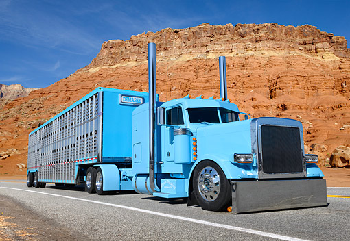 AUT 07 RK0397 01 © Kimball Stock 2004 Peterbilt 379EX Baby Blue 3/4 Front View On Road By Red Rock