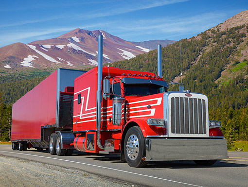 AUT 07 RK0400 01 © Kimball Stock 2013 Peterbilt 389 Red With Canvas Trailer 3/4 Front View On Road In Mountains