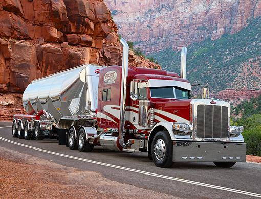 AUT 07 RK0404 01 © Kimball Stock 2012 Peterbilt With Aluminum Trailer Maroon And White 3/4 Front View On Road In Mountains
