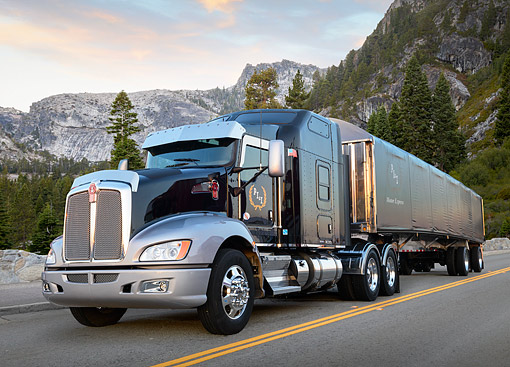 AUT 07 RK0423 01 © Kimball Stock 2013 Kenworth T660 Black And Gray 3/4 Front View On Road By Mountains