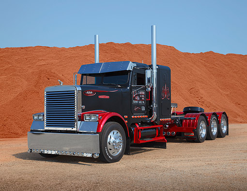 AUT 07 RK0427 01 © Kimball Stock 1988 Freightliner FLC Black And Red 3/4 Front View On Gravel By Red Dirt
