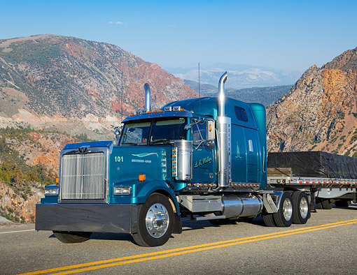 AUT 07 RK0433 01 © Kimball Stock 2005 Western Star 4900EX Jade Green Metallic 3/4 Front View On Road By Mountains