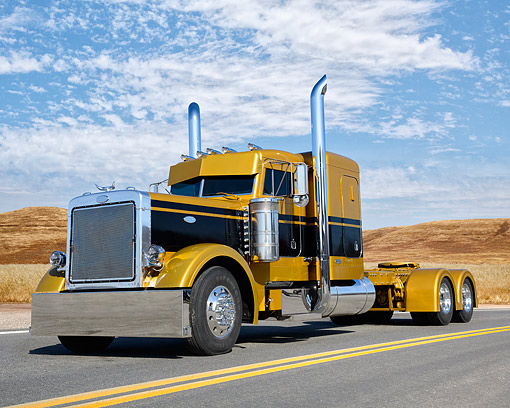 AUT 07 RK0445 01 © Kimball Stock 1993 Peterbilt 379 Extended Hood Amber Gold And Black 3/4 Front View On Road By Field