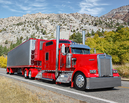 AUT 07 RK0450 01 © Kimball Stock 2000 Kenworth W900 Red 3/4 Front View On Road In Mountains