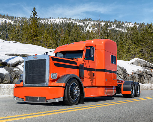 AUT 07 RK0451 01 © Kimball Stock 2000 Peterbilt 379 Legacy Orange With Black Stripes 3/4 Front View On Road By Snowy Mountains