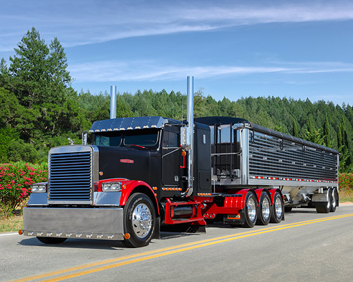 AUT 07 RK0463 01 © Kimball Stock 1988 Freightliner FL C Big Rig Black And Red 3/4 Front View On Mountain Road