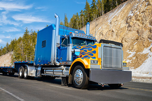 AUT 07 RK0468 01 © Kimball Stock 1996 Western Star Heritage Blue With Flames 3/4 Front View On Road