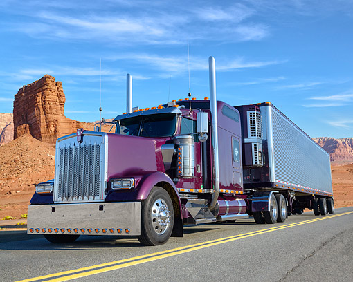 AUT 07 RK0473 01 © Kimball Stock 2000 Kenworth Maroon With Trailer 3/4 Front On Road