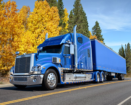 AUT 07 RK0481 01 © Kimball Stock 2007 Freightliner Coronado Blue 3/4 Front On Road By Autumn Trees